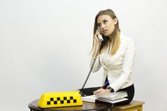 Taxi - girl dispatcher and other materials on the topic of taxi. Taxi industry - dispatcher work reception of orders waiting for the car, telephone conversations stock photo