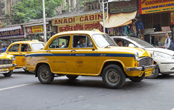 Taxi in Kolkata, India. Urban scene in Kolkata, India. A local taxi driver is driving in the traffic. The metered-cabs are mostly of the brand Ambassador royalty free stock photography