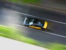 Taxi a la velocidad Imagen de archivo libre de regalías