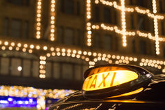 Taxi in London in front of a shopping center Royalty Free Stock Photo