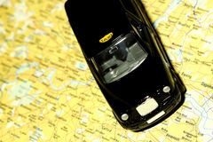 Taxi on map of London Royalty Free Stock Photo