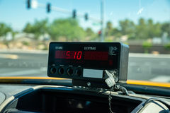 Taxi meter. Calculating passenger fare stock photos