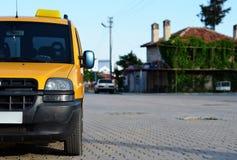 Taxi minivan parked. On resort street Stock Photo