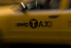 Taxi in Motion. A background with an abstract view of a yellow taxi / cab in New York city royalty free stock images