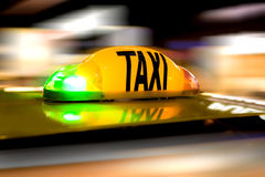 Taxi Sign. Taxi in motion with speed background Stock Photo