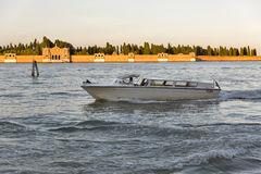 Taxi Motor Boat At Sunset In Venice, Italy. Royalty Free Stock Images