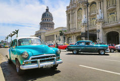 Taxi near the capitol house. Cuba, Havana - 07 April, 2016: Retro taxi driving on the avenue of Havana, traffic consists mainly of American and Sovietic retro stock images