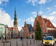 Taxi near House of Blackheads and Christmas tree in Riga. Riga, Latvia - December 26, 2015: Taxi car and People near the House of the Blackheads and the stock photo