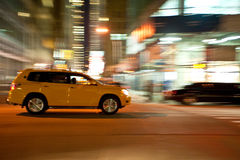 Taxi at night, blurred with motion Stock Photography