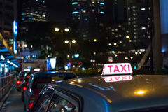 Taxi in the night Royalty Free Stock Images
