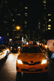 Taxi at night in Midtown Manhattan, New York. Royalty Free Stock Photo