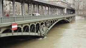 Taxi over Bir-Hakeim bridge. PARIS, FRANCE - JAN 30, 2018: Pont de Bir-Hakeim and swollen river Seine embankments overflow flooding in Paris - news footage stock video