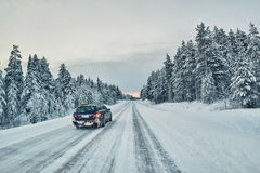 Taxi overtaking on a slippery winter road in Lapland, Finland Royalty Free Stock Image