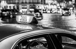 Taxi in Paris. Parisien. Car closeup at night time. Black and white stock photography