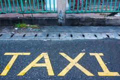 Taxi parking sign on a the street.Thailand. Taxi parking sign on a the street.Thailand Royalty Free Stock Image