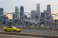 Taxi passes along pedestrian The Helix Bridge Royalty Free Stock Photos