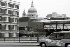 Taxi past St Pauls. A taxi travelling past St Pauls cathedral, London Stock Photos