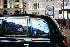 Taxi at Piccadilly Circus Stock Image