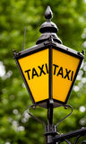 Taxi post with clipping path. Taxi post on green background with clipping path Stock Photo
