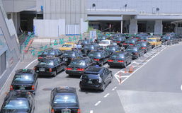 Taxi queue Japan. Taxis wait for passengers at Osaka Station in Osaka Japan Royalty Free Stock Image