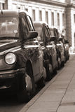 Taxi Rank. London taxis on a taxi rank in black and white Royalty Free Stock Photography