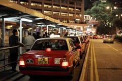 Taxi rank in Hong Kong. City at night royalty free stock photo