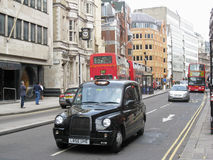 Taxi and Red Bus in London Stock Image