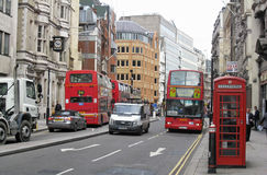 Taxi and Red Bus in London Royalty Free Stock Image