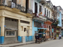 TAXI RICKSHAWS AND COLORFUL FACADES, HAVANA, CUBA Stock Photo
