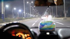 Taxi rides in Egypt, Sharm El Sheikh. Inside view of the night resort town, palm trees, cars and roads. stock video