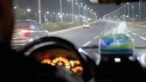 Taxi rides in Egypt, Sharm El Sheikh. Inside view of the night resort town, palm trees, cars and roads. stock footage