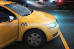 Taxi on the road with the lights on. The flow of machines Royalty Free Stock Photos