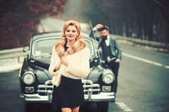 Taxi on road with luxury couple. taxi driver and woman at retro car. stock image