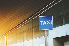 Taxi road sign near airport or mall entrance. Billboard with TAXI caption with copy space area for your text message or promotional content, taxi road sign near Royalty Free Stock Image