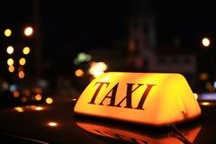 Taxi roof top light at night. Closeup Stock Image