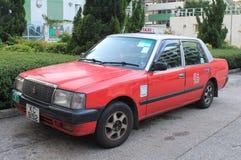 Taxi rouge à Hong Kong photographie stock libre de droits