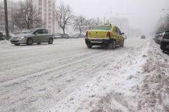 Taxi runing on blizzard Stock Photography