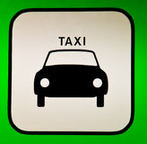 Taxi sign. A Taxi sign with a green frame Stock Images