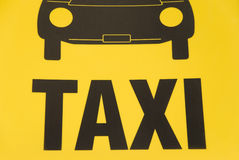 Taxi sign. German yellow taxi sign with symbolic car Stock Photography