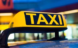 Taxi sign. On the roof of a car Stock Images