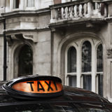 Taxi sign. On Cab in Westminster, London Royalty Free Stock Images