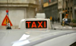Taxi sign. On a white car on the streets of florence in Italy Stock Photos
