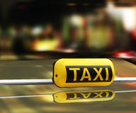 A taxi sign. At night Royalty Free Stock Image