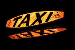 Taxi Sign 2. Taxi sign lit up showing the word Taxi and the disabled symbol Stock Photo