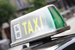 Taxi sign. On a roof of car close-up Stock Image