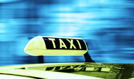 Taxi sign. In a motion background Stock Photography