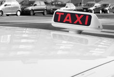 Taxi Sign. Close-up of red taxi sign in the city Stock Photos