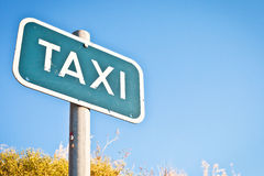 Taxi sign. With copyspace and a summer feel Royalty Free Stock Photos
