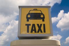 Taxi sign. Against cloudy sky Stock Photo