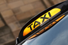 Taxi Sign. An illuminated modern style Taxi Sign advertising trade at a taxi rank Stock Image